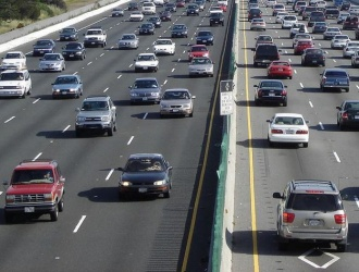 Record low gas prices expected to fuel higher than expected holiday travel